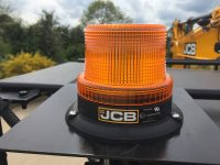 wheeled excavator hire with orange beacon
